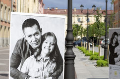 Celebrities and children with down syndrome on the posters. St. Petersburg, Russia - July 23, 2017: Posters with a charity project to help children with Down`s Stock Photos