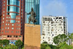 Celebrities statue and modern buildings in Ho Chi Minh City view, VietNam Royalty Free Stock Photo