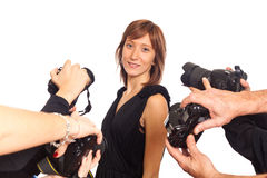 Celebrity. Woman in front of Paparazzi stock photos