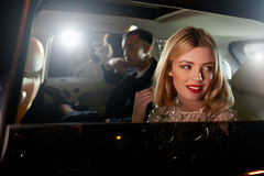 Celebrity couple in back of a car, photographed by paparazzi Royalty Free Stock Image