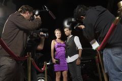 Celebrity Couple Being Photographed. At media event stock image
