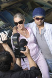 Celebrity Couple And Paparazzi Stock Photo