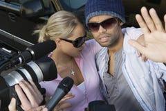 Celebrity Couple And Paparazzi. Closeup of celebrity couple and paparazzi stock photography