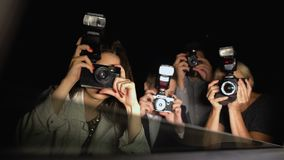 Celebrity looking from car at newspaper paparazzi making shoots, point of view