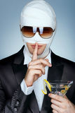 Celebrity patient in medical bandage and sunglasses after beauty Plastic Surgery. Royalty Free Stock Photo