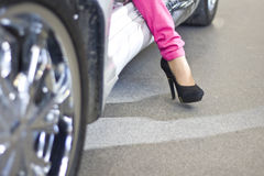 Celebrity woman exiting sportcar Stock Images