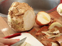 Celeriac and onion partly cut Royalty Free Stock Image