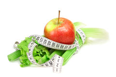 Celery apple and measure tape. Diet concept isolated on white Stock Photos