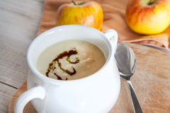 Celery apple vegetable cream soup in white bowl Royalty Free Stock Photos