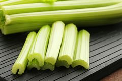 Celery. On black cutting board Stock Photo
