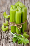Celery. Bunch of fresh celery stalks on a wooden background Stock Image