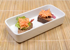 Appetizer. Celery and carrot appetizer salad with slices of whole wheat bread on white plate Stock Photos