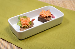 Delicious Vegetables Snack. Celery and Carrot salad with slices of whole wheat bread on a white plate Stock Images