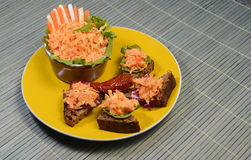 Healthy Salad Lunch. Celery and Carrot salad with slices of whole wheat bread on a yellow plate Stock Photo