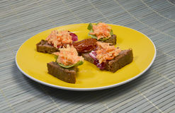 Healthy Snack. Celery and Carrot salad with slices of whole wheat bread on a yellow plate Stock Photo
