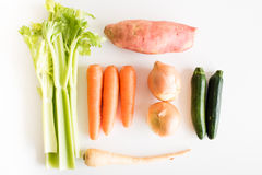 Celery, carrots, onions, sweet potato, zucchini and parsnip from above Royalty Free Stock Photography