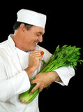 Celery Feeding Chef Royalty Free Stock Photos