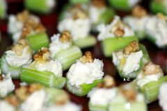 Celery, gorgonzola and walnuts stock image