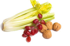 Celery grapes & walnuts. Celery with red grapes and walnuts Stock Images
