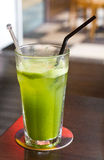 Celery juice. Freshly squeezed with straw royalty free stock photo