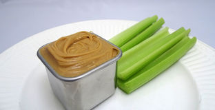 Celery and nut butter. Stock Images