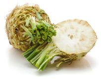 Celery. One whole and half of fresh celery root  on white background cross section Royalty Free Stock Images