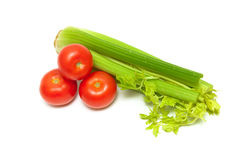 Celery and ripe tomatoes isolated on white background Stock Images
