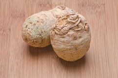 Celery root. Natural celery root on a wood cutting board Royalty Free Stock Image
