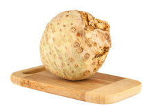 Celery root on chopping board Royalty Free Stock Photography