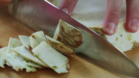 Celery root cutting; close up; stock video footage