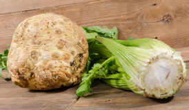 Celery root and green celery. On wooden background Stock Photography
