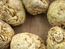 Celery root in market as background. Celery roots in market place as background Royalty Free Stock Photo