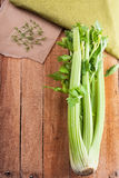 Celery and salad crees. Bunch celery and salad crees on the on light wooden background Stock Photography
