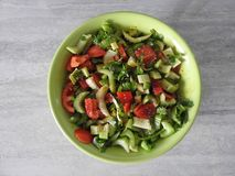 Celery salad with fresh vegetables close-up in a plate on the table royalty free stock photo
