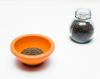 Celery Seeds. In bowl and bottle on white background royalty free stock image