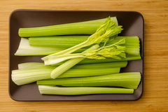 Celery stalks. On a platter. Royalty Free Stock Photography
