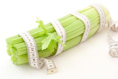 Celery with tape measure Royalty Free Stock Images