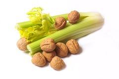 Celery & Walnuts. Bunch of fresh, crispy celery with walnuts Royalty Free Stock Image