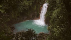 Celeste river waterfall, Tenorio Volcano, Costa Rica. Super slow motion of celeste river waterfall, Tenorio Volcano, Costa Rica stock video footage