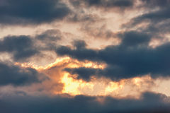 Celestial Battle. Cloud in the form of a crocodile absorbs light at sunset enemy. Stock Image