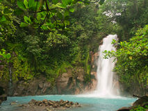 Celestial blue waterfall. In Costa Rica stock images