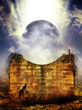 Celestial event. A mysterious brick wall structure with a planet (moon) rising in the background depicting a celestial event stock photo