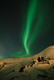 Celestial flame. Vertical ray of Aurora polaris stock photos