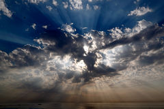 Celestial sunbeams. Real dark sky with sun and sunbeams in the Portuguese Coast - low edition photo stock photos
