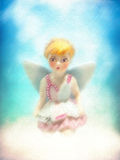 Painterly angel  Celestial young little blonde girl fairy sitting on a cloud Royalty Free Stock Photo