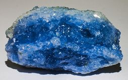 Celestine or celestite blue mineral stone crystal gem. Celestine or celestite is a mineral consisting of strontium sulfate SrSO4. The mineral is named for its stock photography