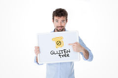 Celiac man showing his problem on a board Royalty Free Stock Photos