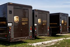 United Parcel Service hybrid electric vehicles. UPS is the World`s Largest Package Delivery Company II stock photo
