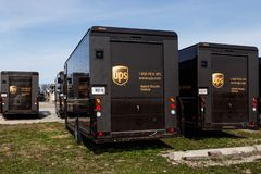United Parcel Service hybrid electric vehicles. UPS is the World`s Largest Package Delivery Company III stock photo