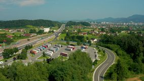 Truck stop and petrol station on highway, aerial view, A1 higway near Celje, Slovenia. Celje, Slovenia - July 6 2019: Aerial view of Lopata truck stop and petrol stock footage